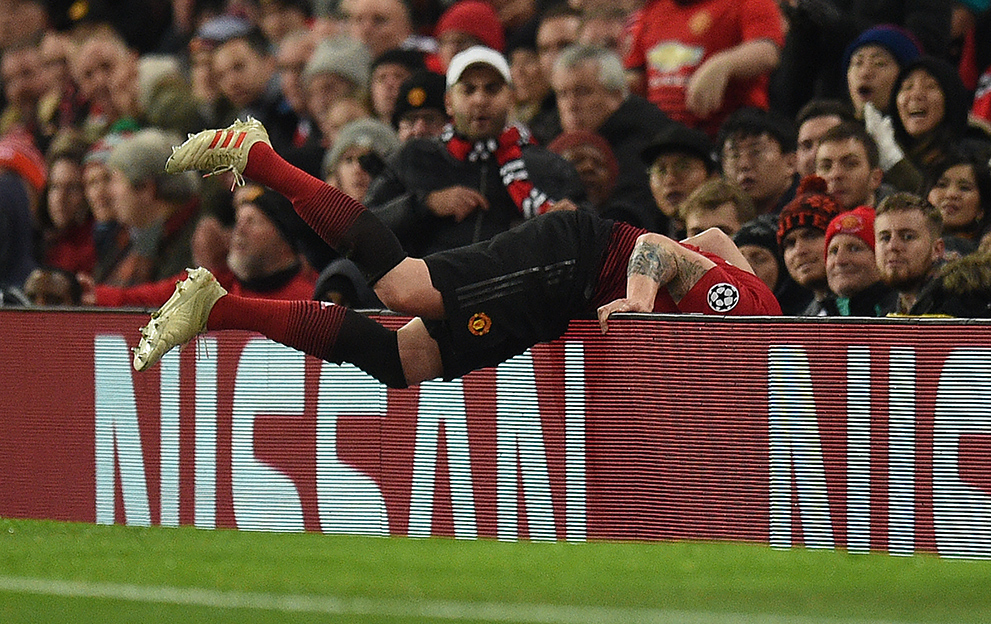 Phil-Jones-CL-falling-over-hoarding