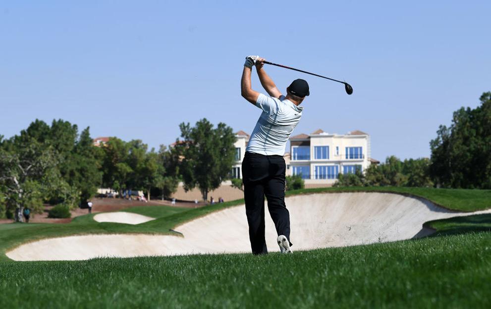 Tom Lewis of England takes a shot during the DP World Tour Championship at Jumeirah Golf Estates in Dubai on November 22, 2019. (Photo by KARIM SAHIB / AFP) (Photo by KARIM SAHIB/AFP via Getty Images)