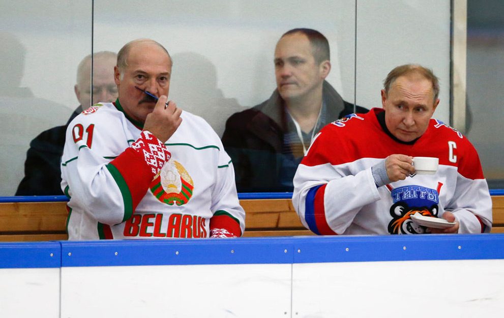 Russian President Vladimir Putin (R) and Belarusian President Alexander Lukashenko take part in an ice hockey match at Rosa Khutor outside the Black Sea resort of Sochi, on February 7, 2020, as part of Lukashenko's visit to Russia. (Photo by Alexander Zemlianichenko / POOL / AFP) (Photo by ALEXANDER ZEMLIANICHENKO/POOL/AFP via Getty Images)