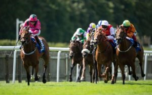 Jockey Cieren Fallon (L) rides Oxted to victory in the July Cup at Newmarket Racecourse ahead of Frankie Dettori on Irish raider Sceptical with favourite Golden Horde third in Suffolk on July 11, 2020